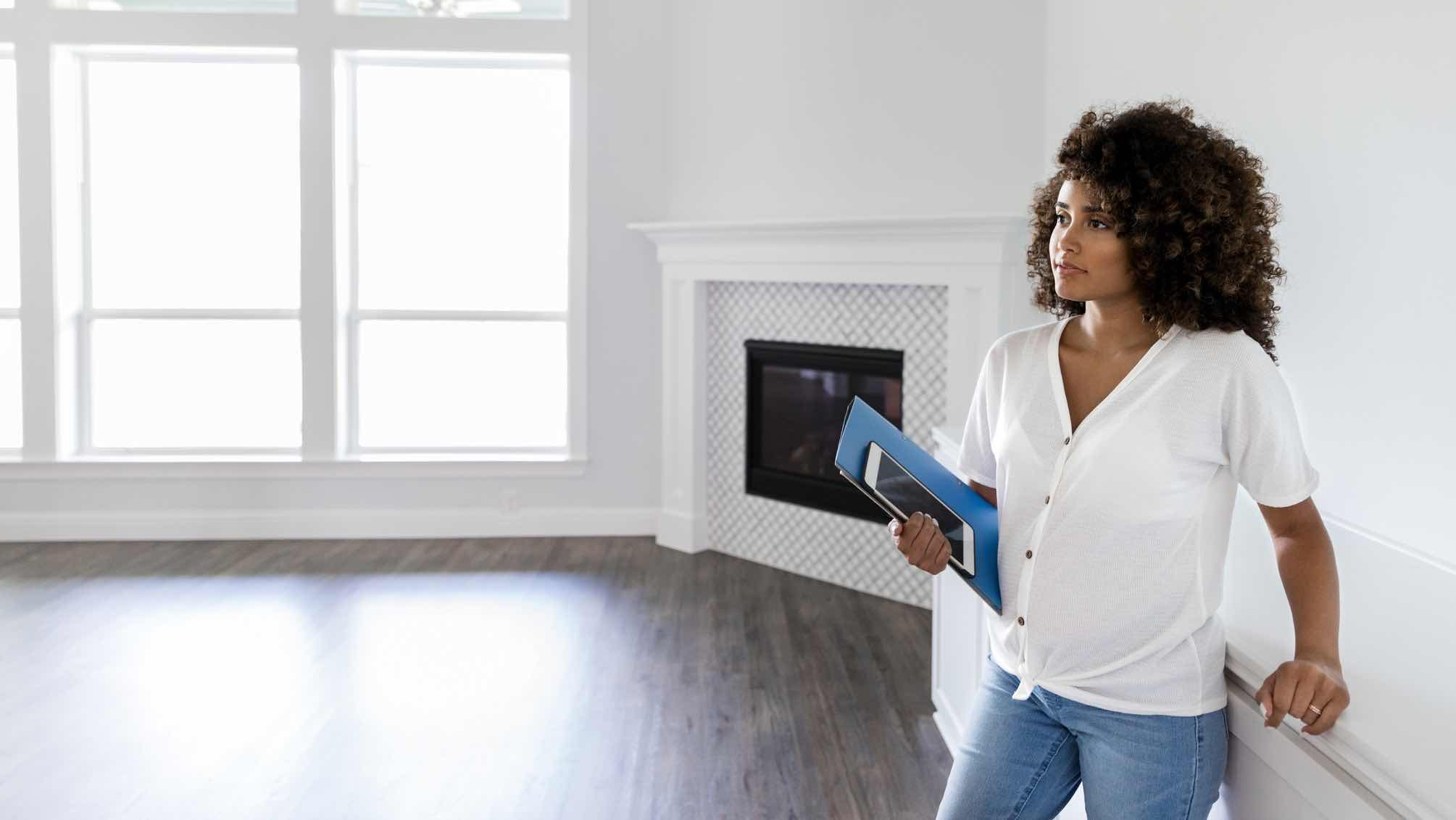 Woman in an unfurnished house considering home loan revert rates.