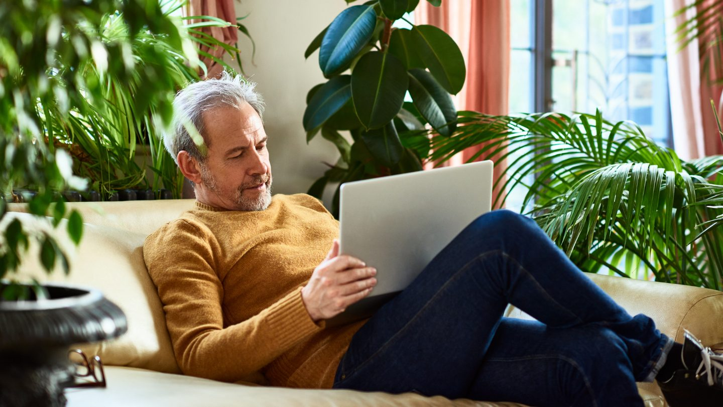 Man on laptop looking to consolidate superannuation.