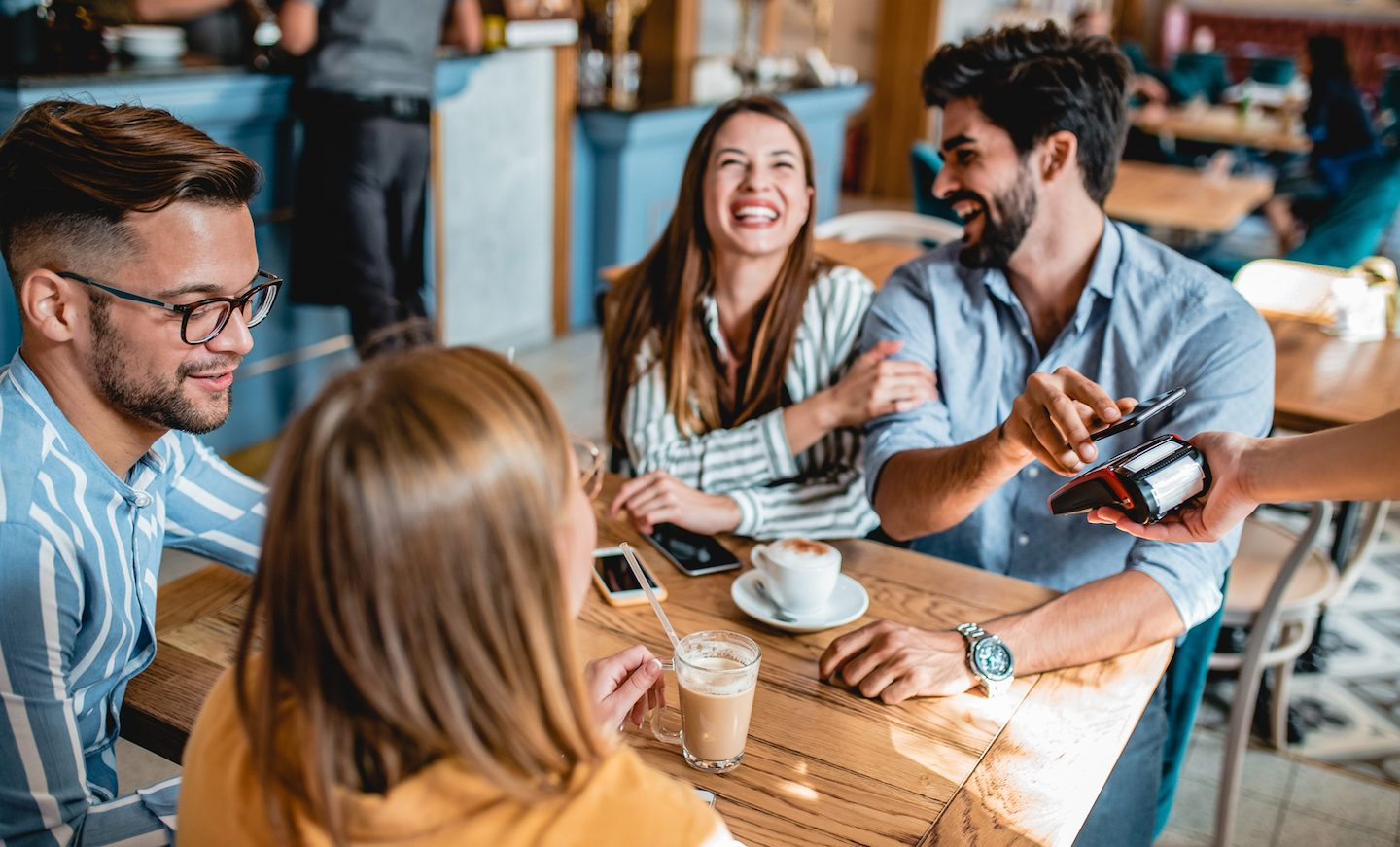 young-group-of-friends-using-credit-card-cashback-offer