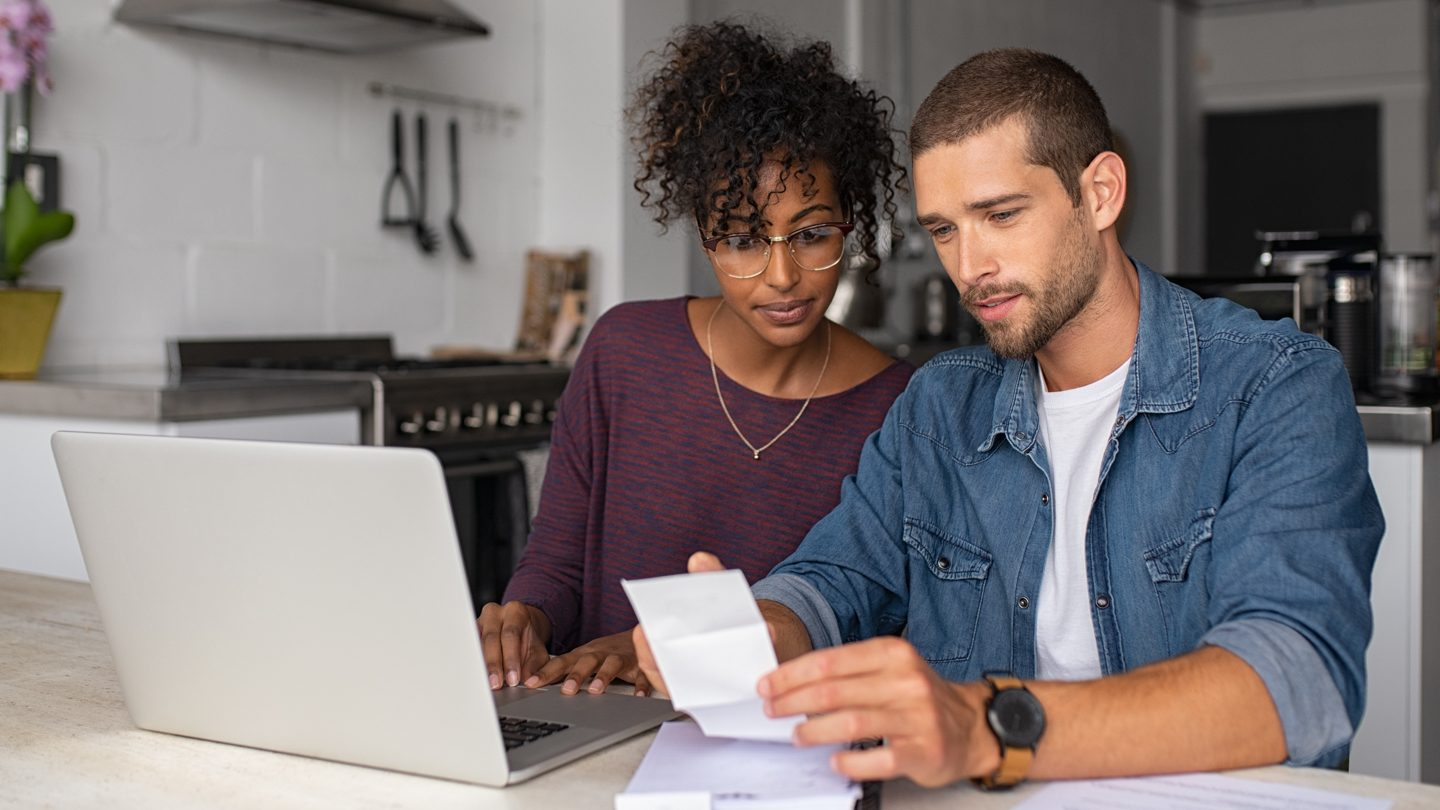 young-couple-on-laptop-reviewing-spending-and-debt