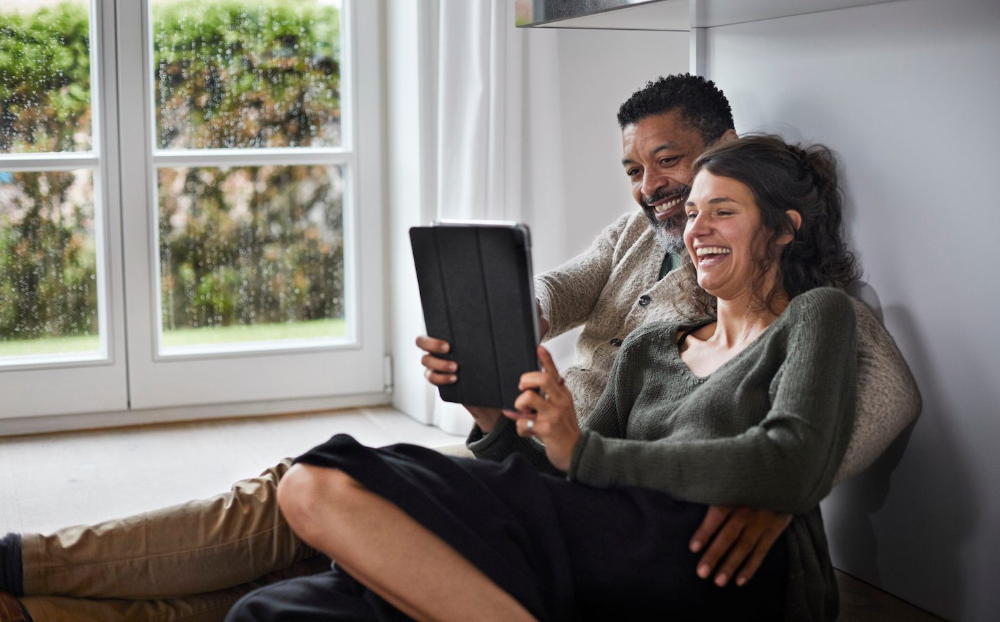 couple on tablet using SuperApp by Revolut