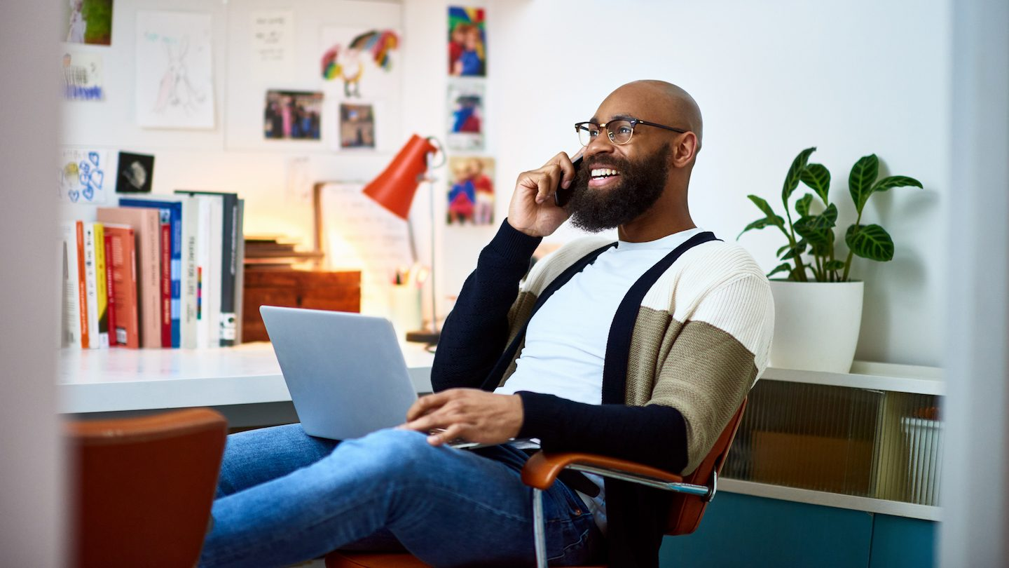 man on laptop taking out short term personal loan