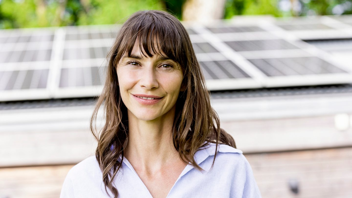 woman in front of solar panels
