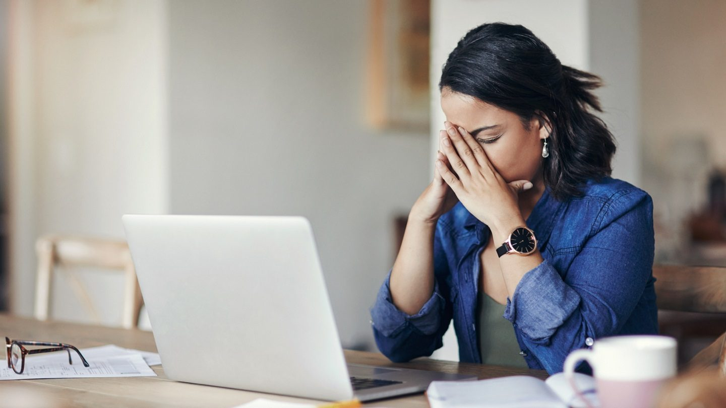 Small business woman stressed over cashflow issues