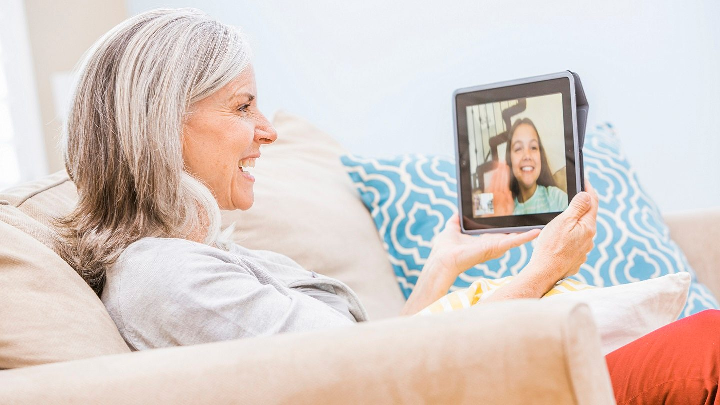 Woman video-calling her granddaughter to stay connected