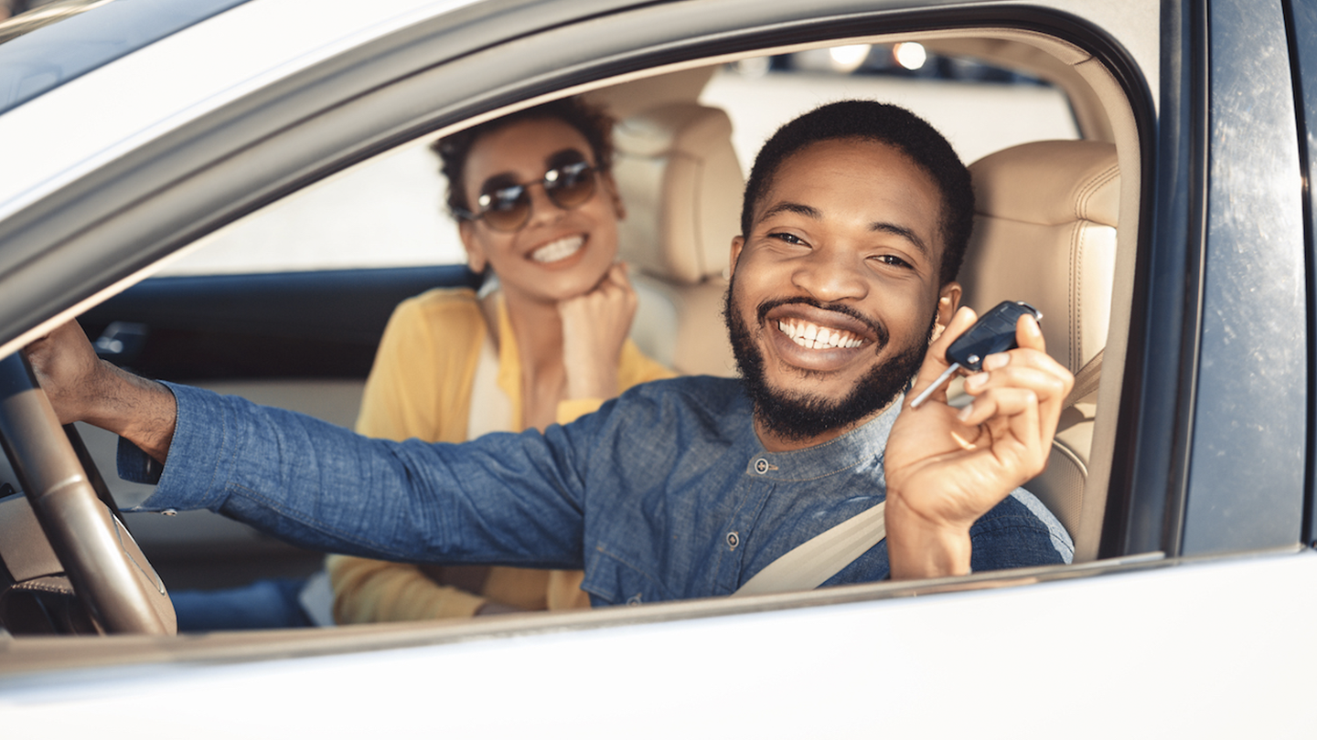 Man in new car with keys