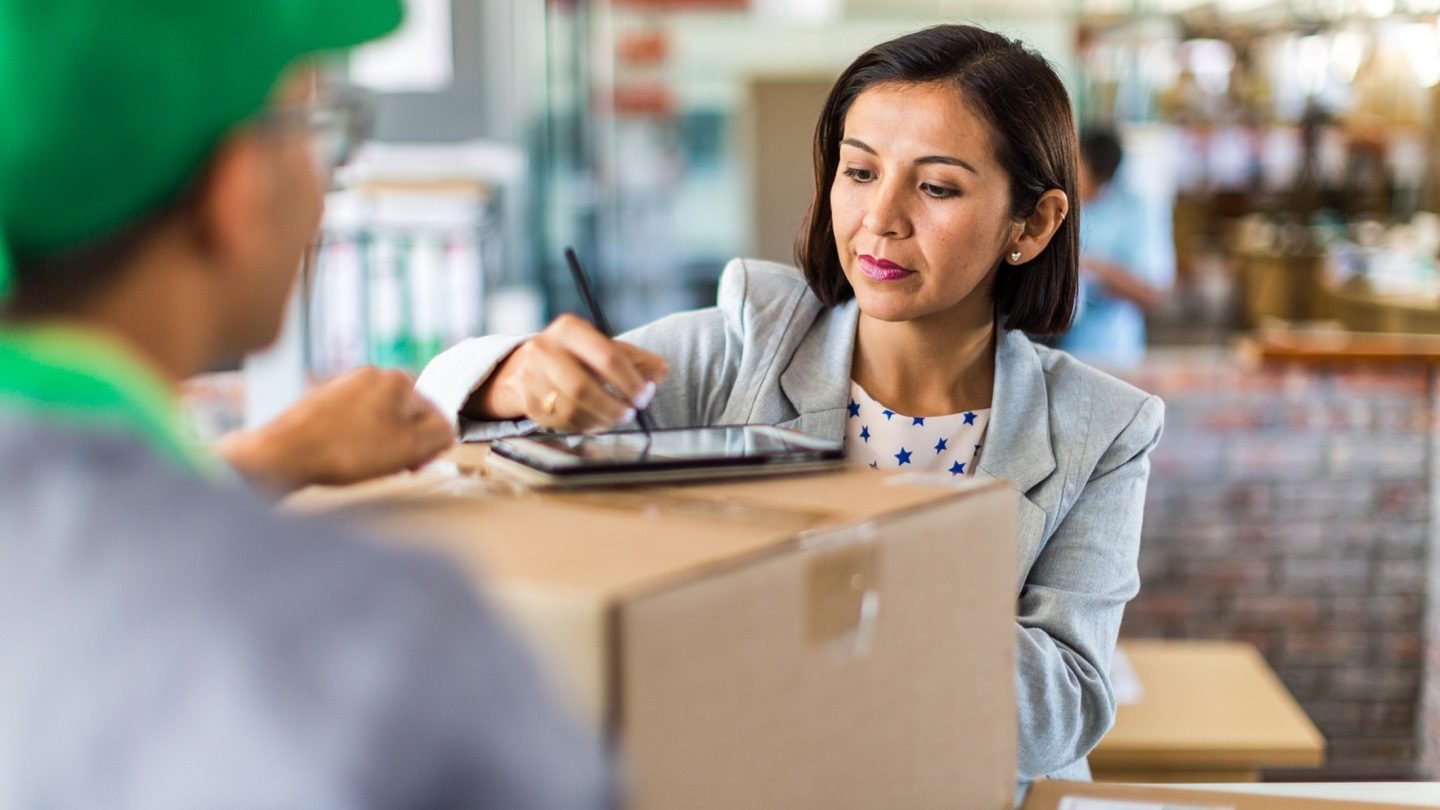 small business supplier signing off on a package