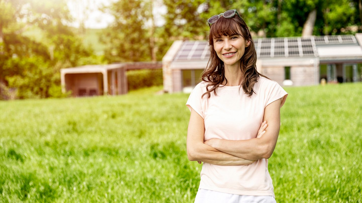 woman with solar panels bought using green loan