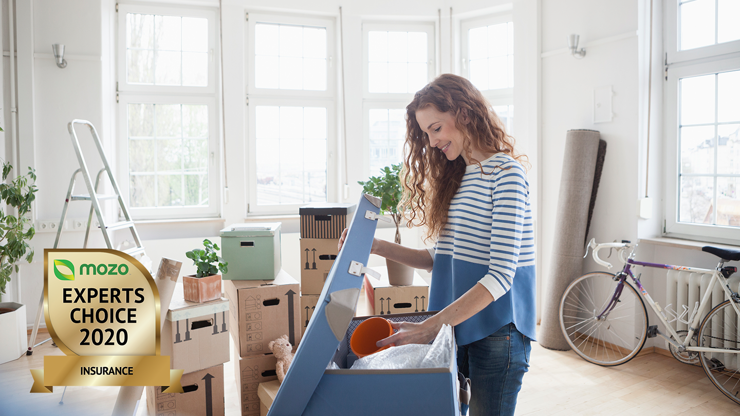 Woman packing home with Woolworths Insurance