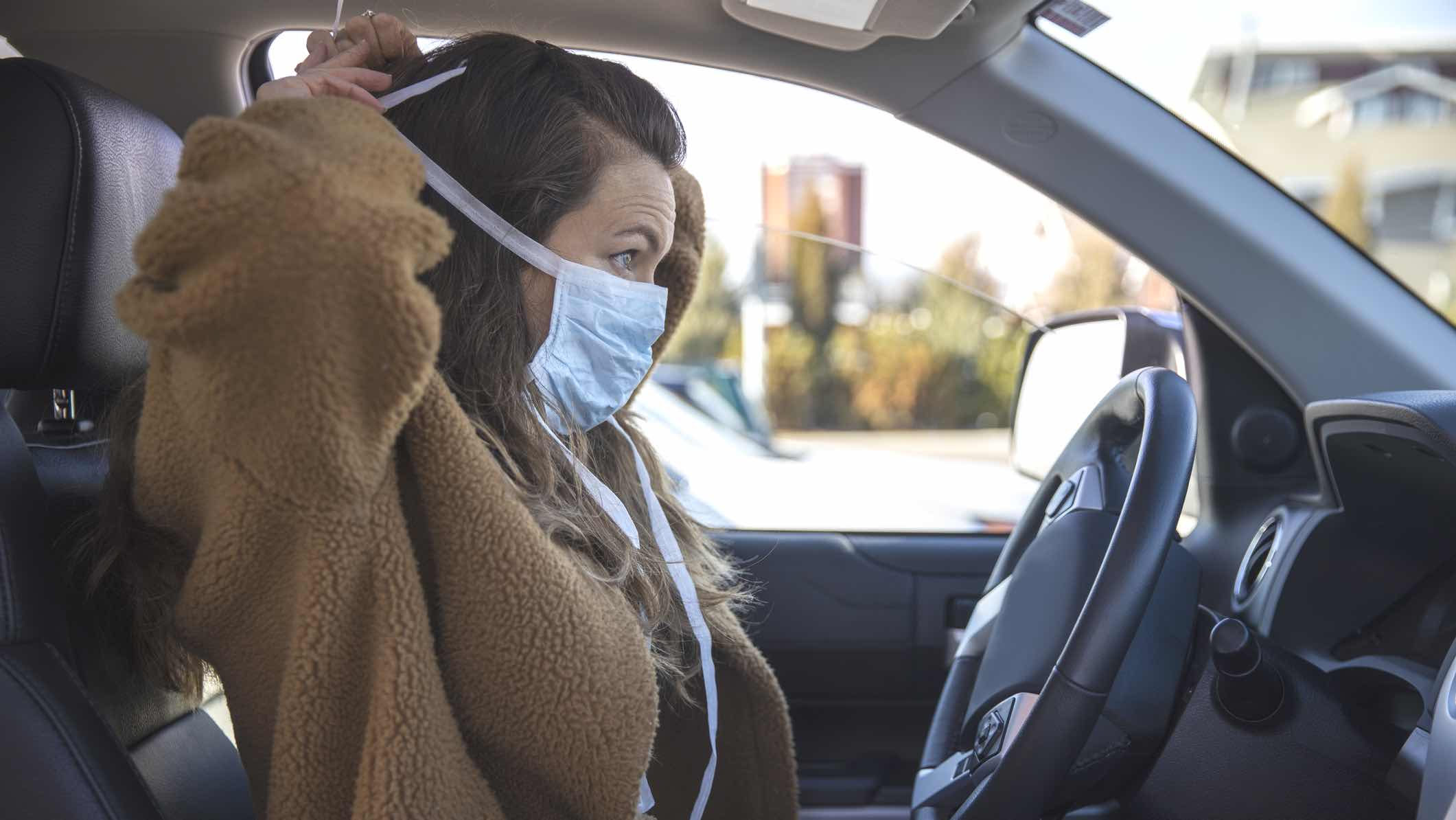 Driver wearing a face mask during COVID-19