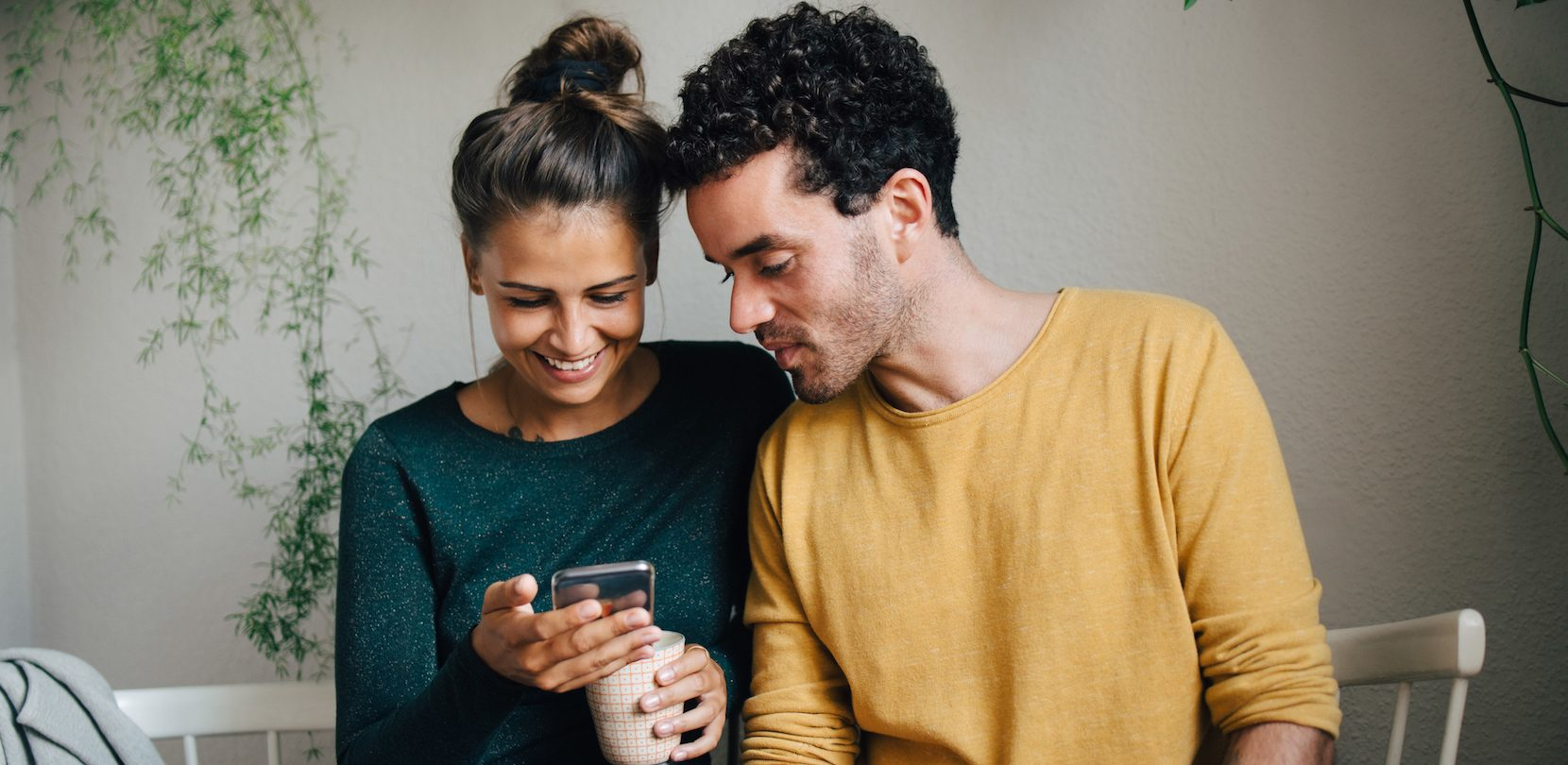 couple on their phone using PayPal's Instant Transfer