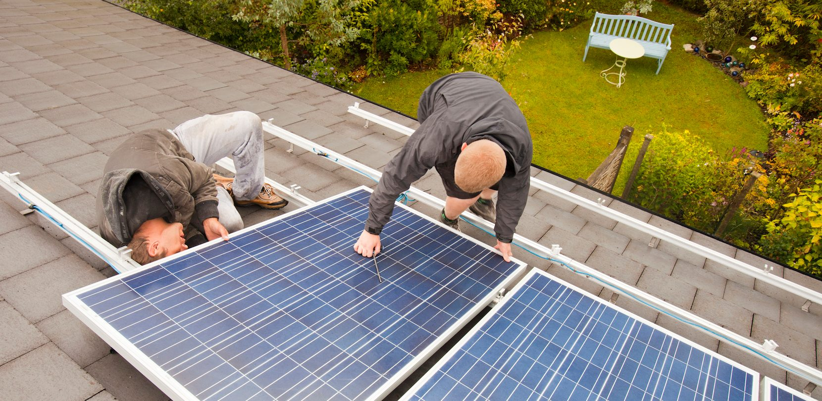 men installing solar panels bought with green loan