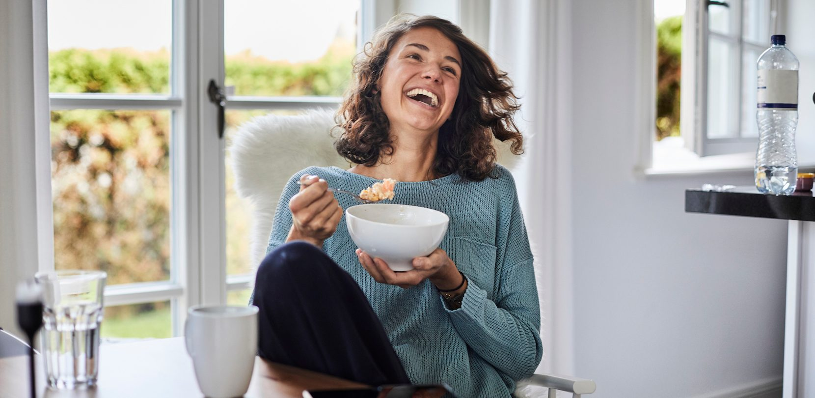 happy woman smiling because of slashed home loan rate