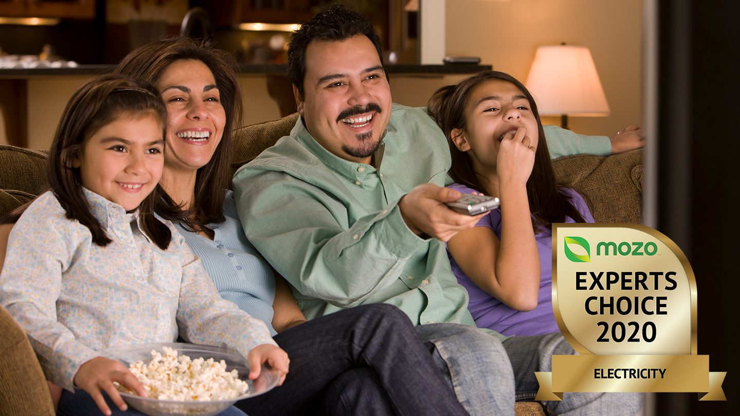 Family watching television powered by electricity