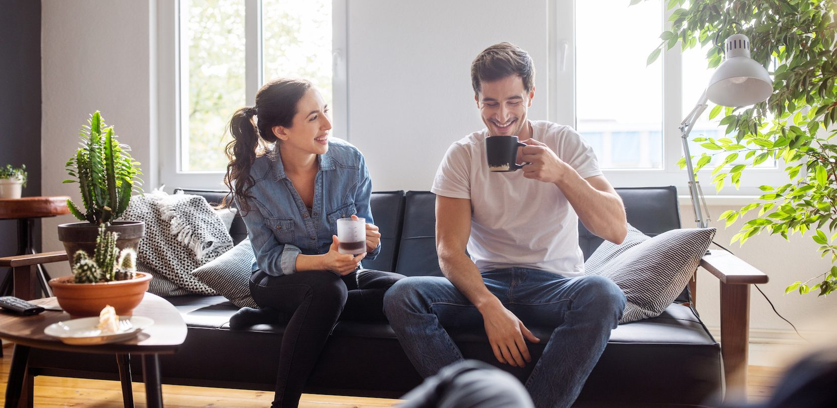 young couple in home bought with home loan