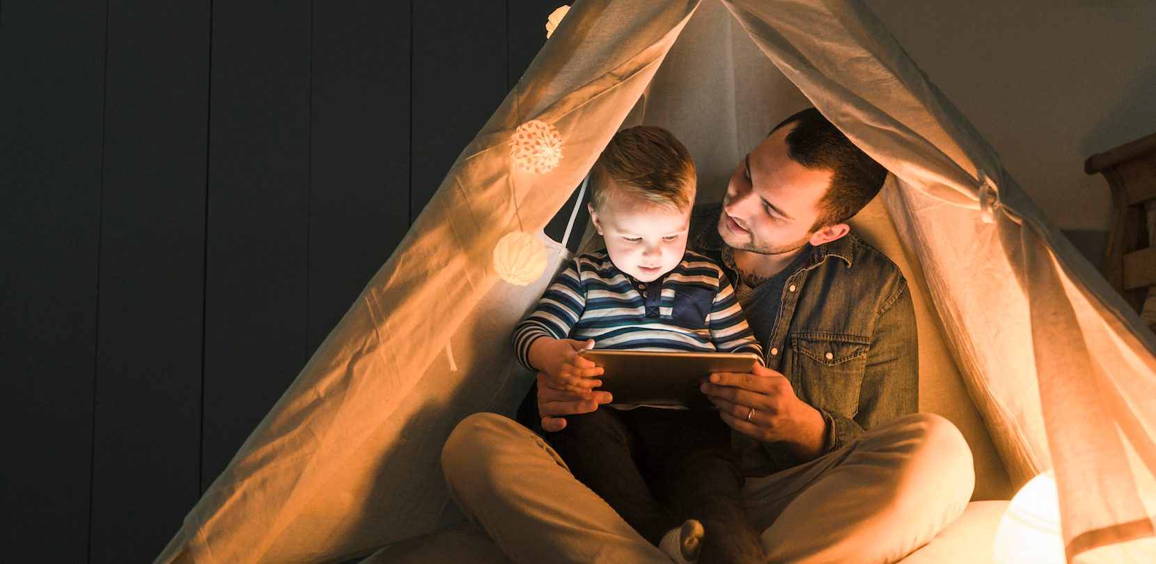 dad-and-son-in-tent-using-energy