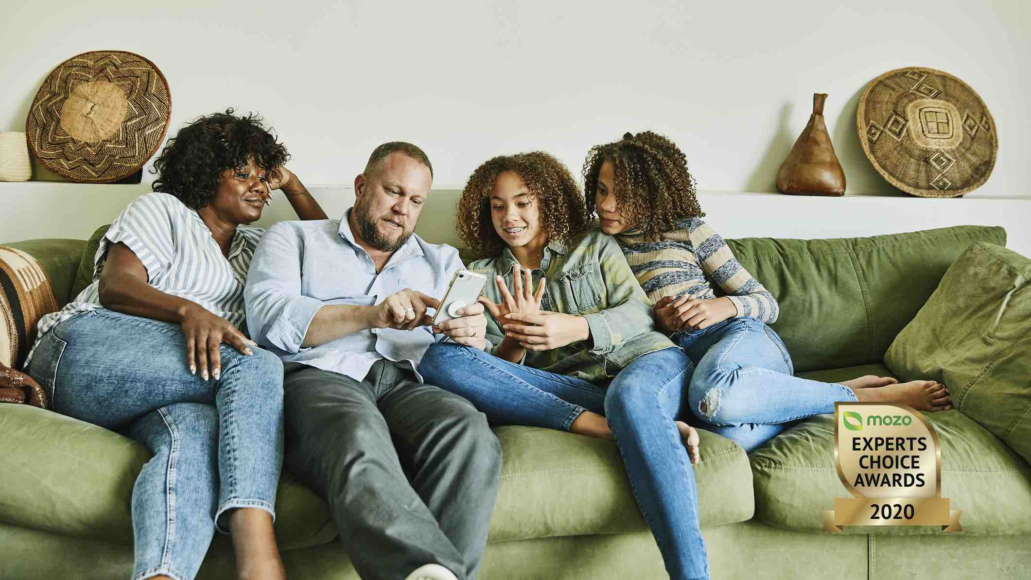Family on a lounge looking at home insurance online
