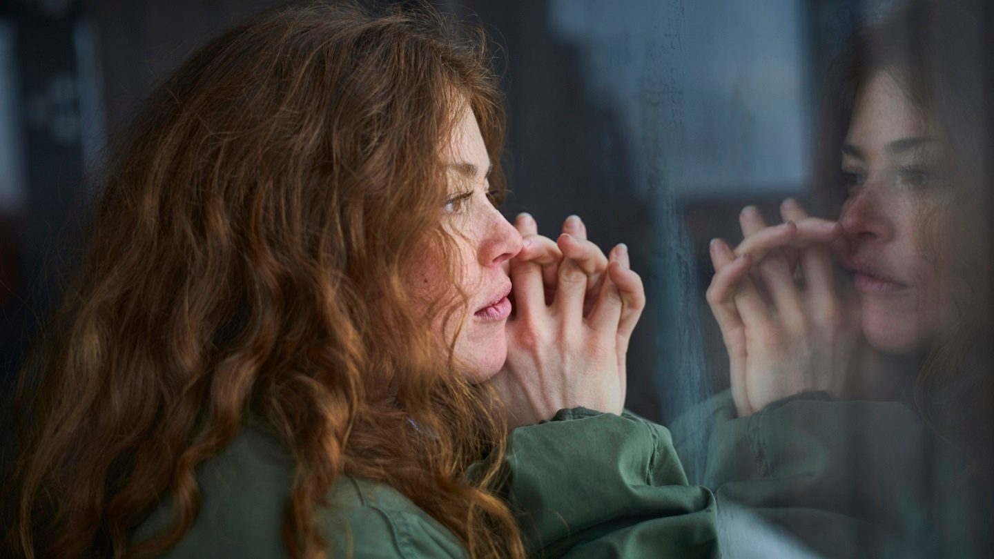 Woman contemplating and planning her financial future