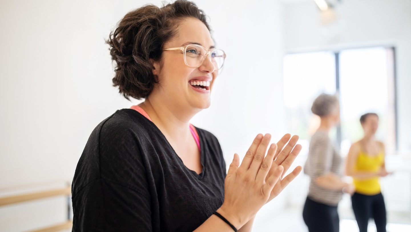 woman clapping about Westpac's Mozo Experts Choice Awards win