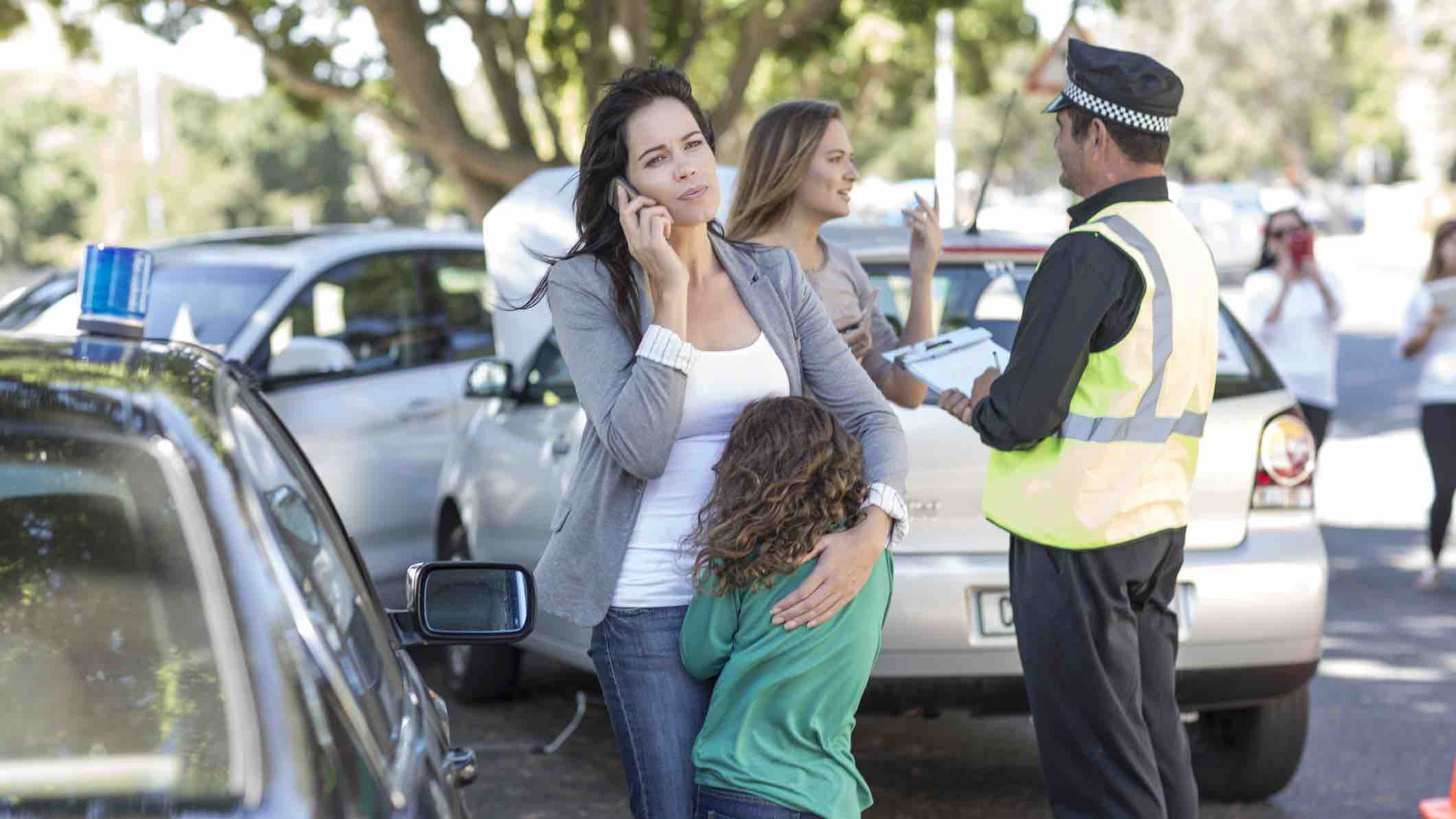 Family after a car accident calling to claim insurance