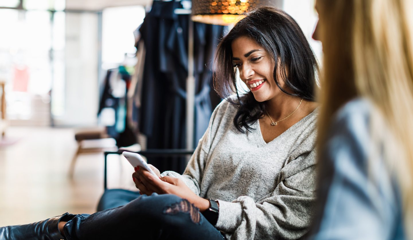 woman-on-her-phone-using-Afterpay-and-Westpac-account