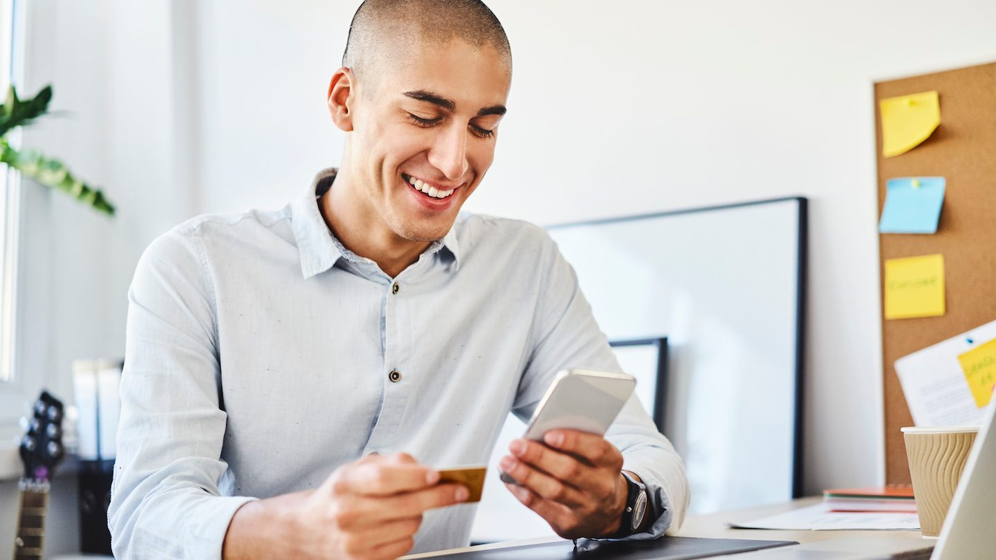young businessman using Archa neo business credit card