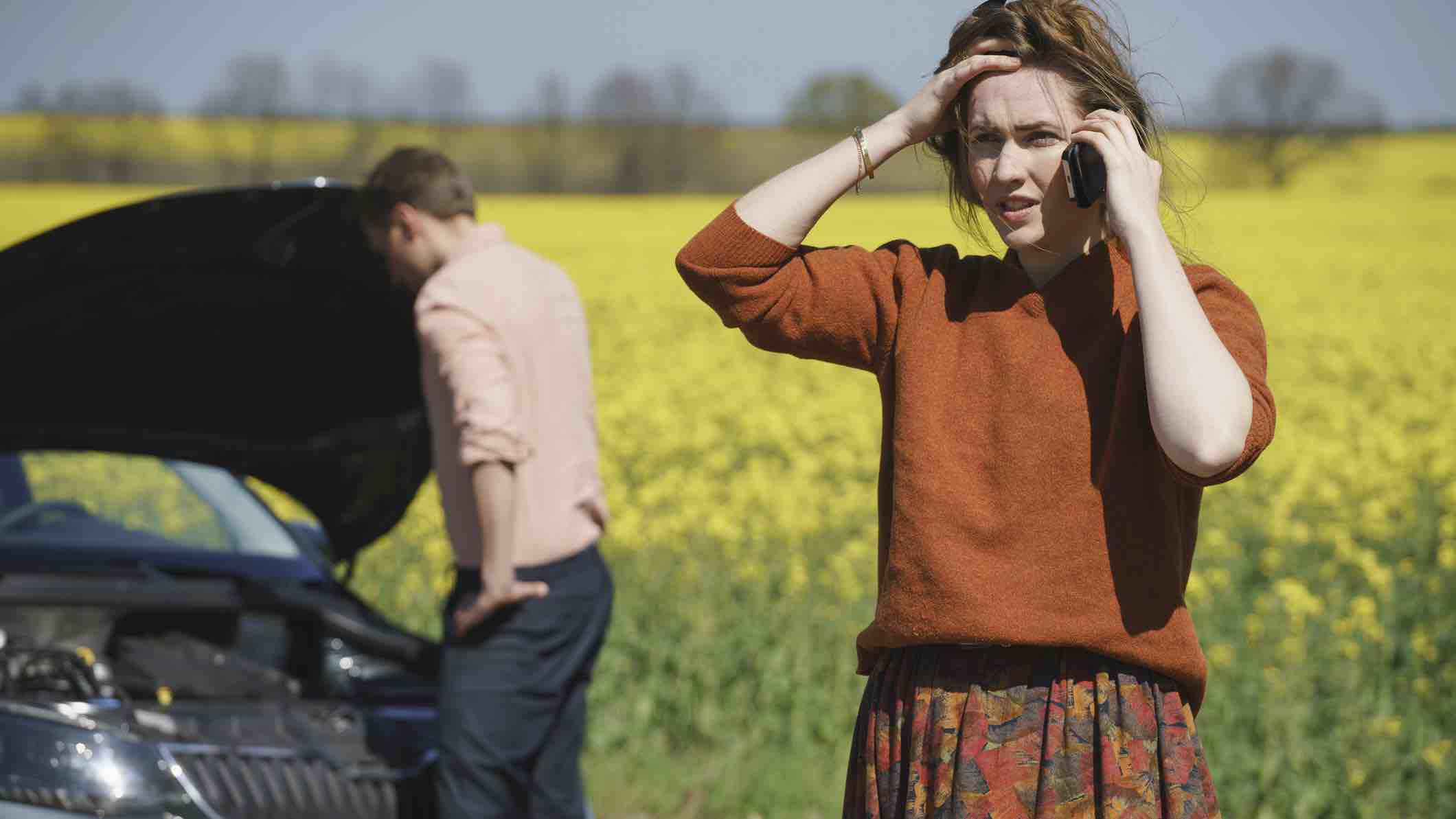 Woman on phone to insurance about written off car
