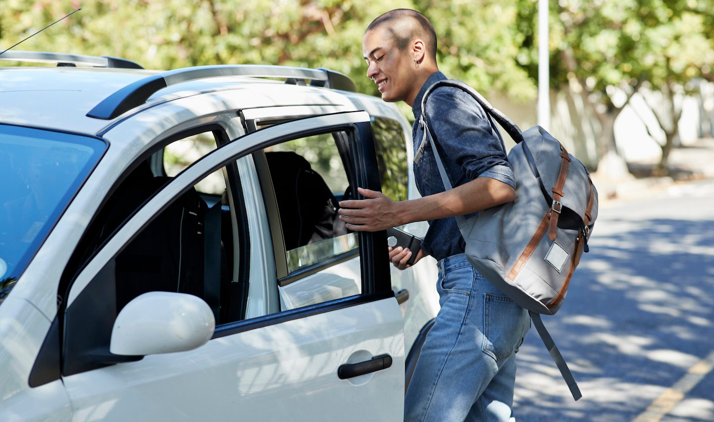 man getting into his new car with same insurance policy