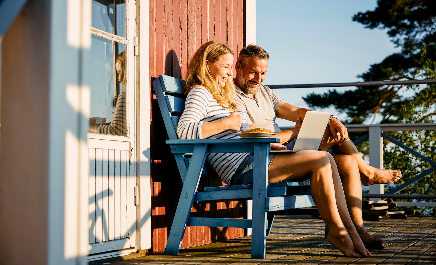 couple-on-balcony-looking-at-personal-loans-on-laptop
