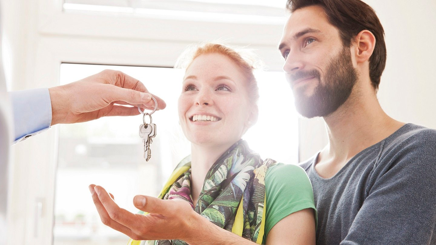 First home buyers accepting house keys