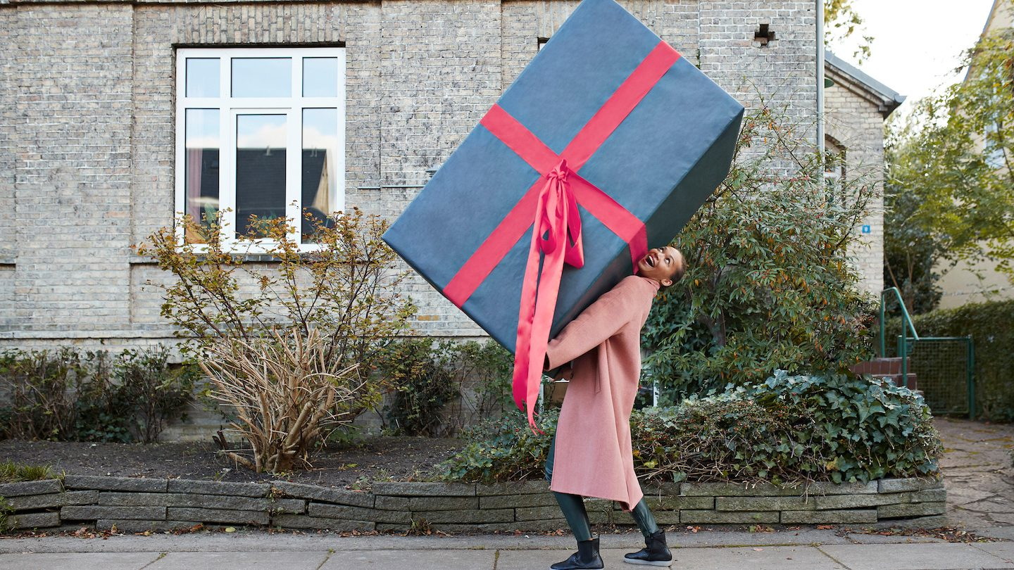 woman carrying gift bought with credit card