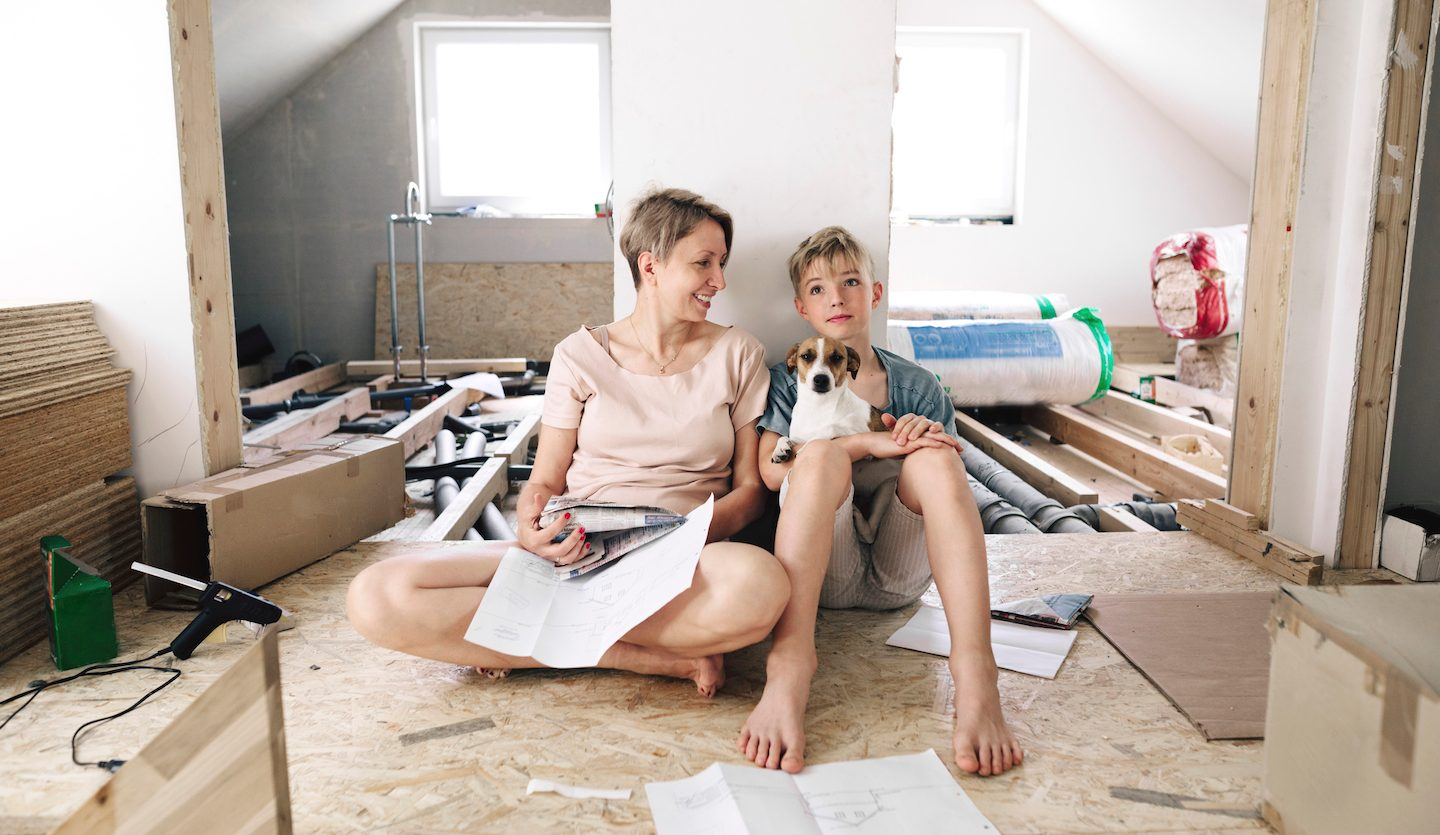 mother and son renovating house using personal loan