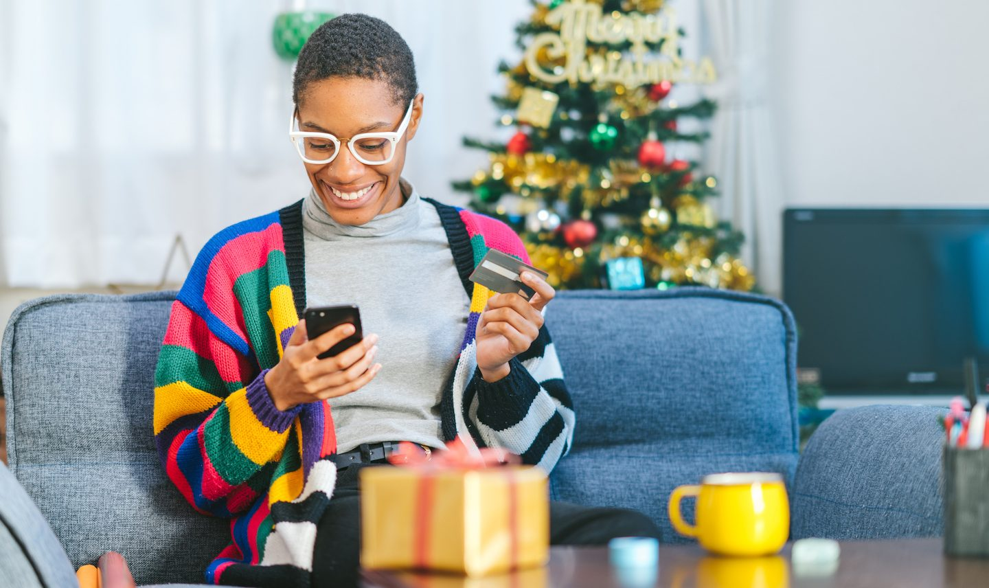 woman using credit card with buy now pay later at christmas