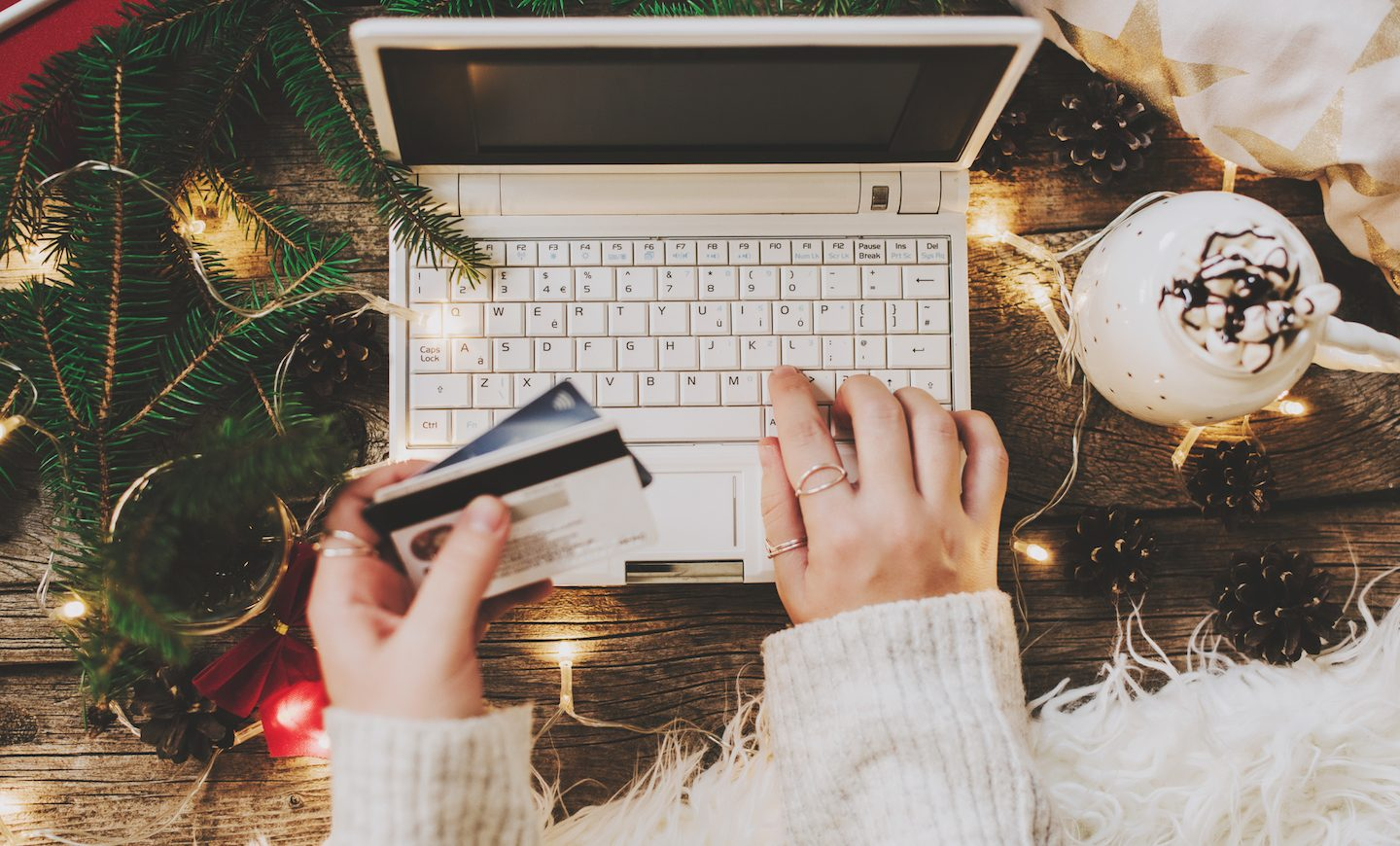 woman-using-credit-card-safely-online-for-christmas-shopping