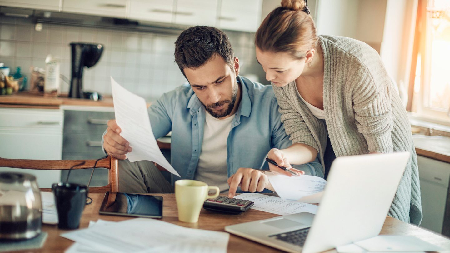 young couple working out cost of revert rate on fixed rate home loan