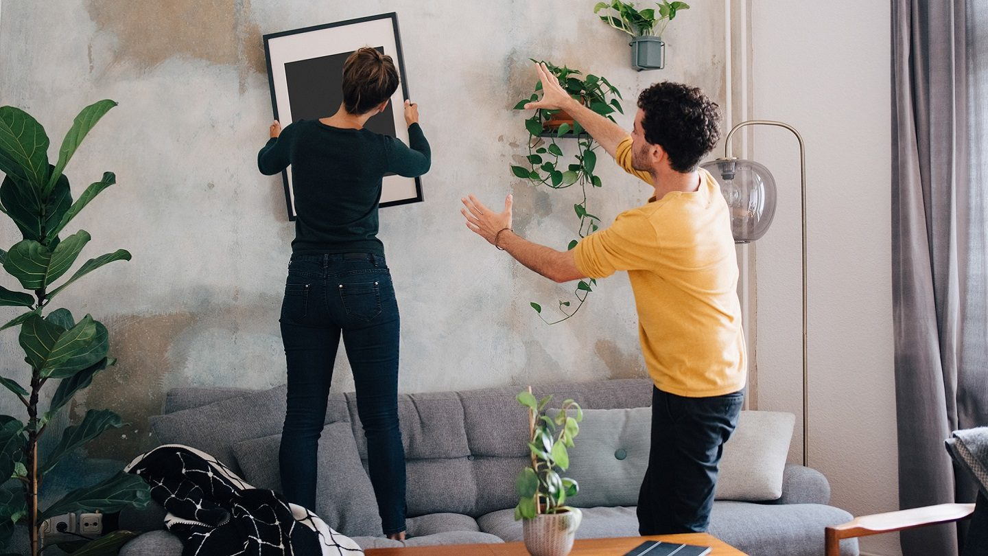 Couple decorating their home