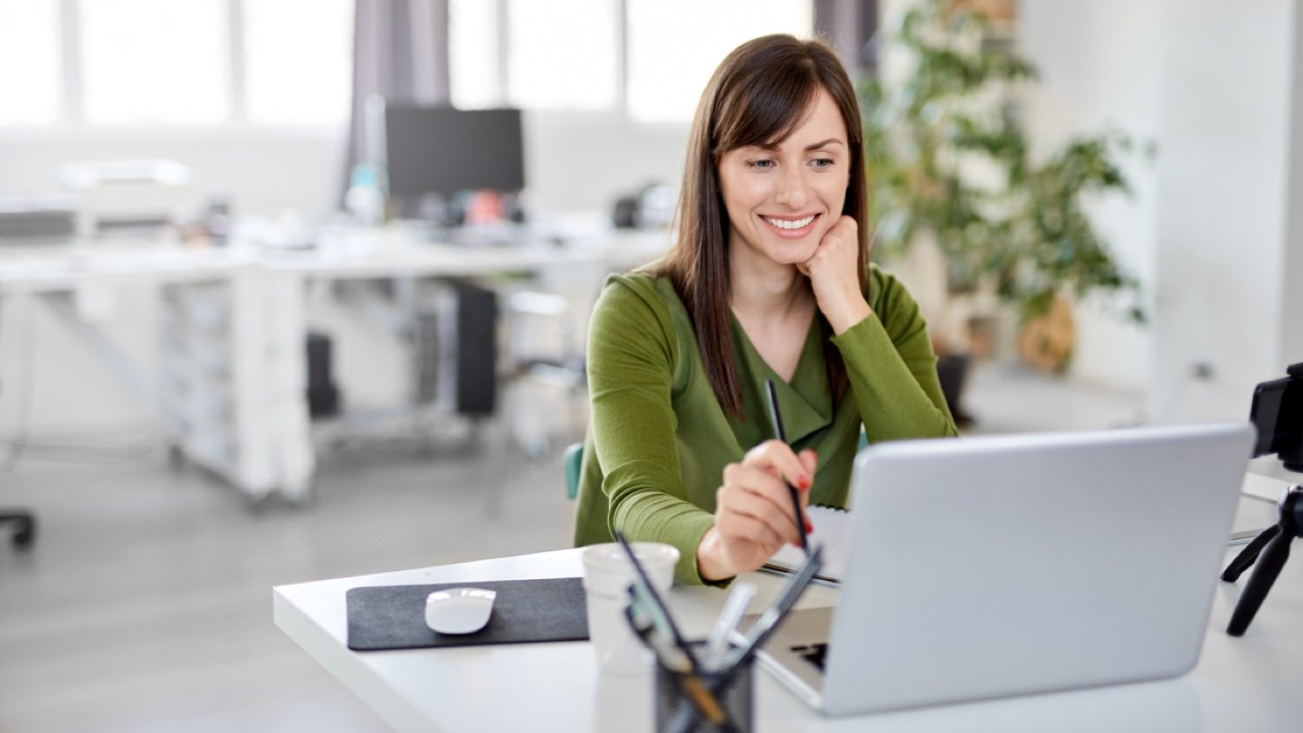 woman-in-green-shirt-on-laptop