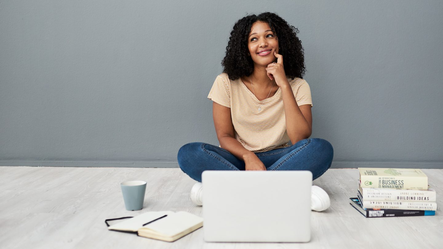 woman on her laptop upskilling her financial know-how