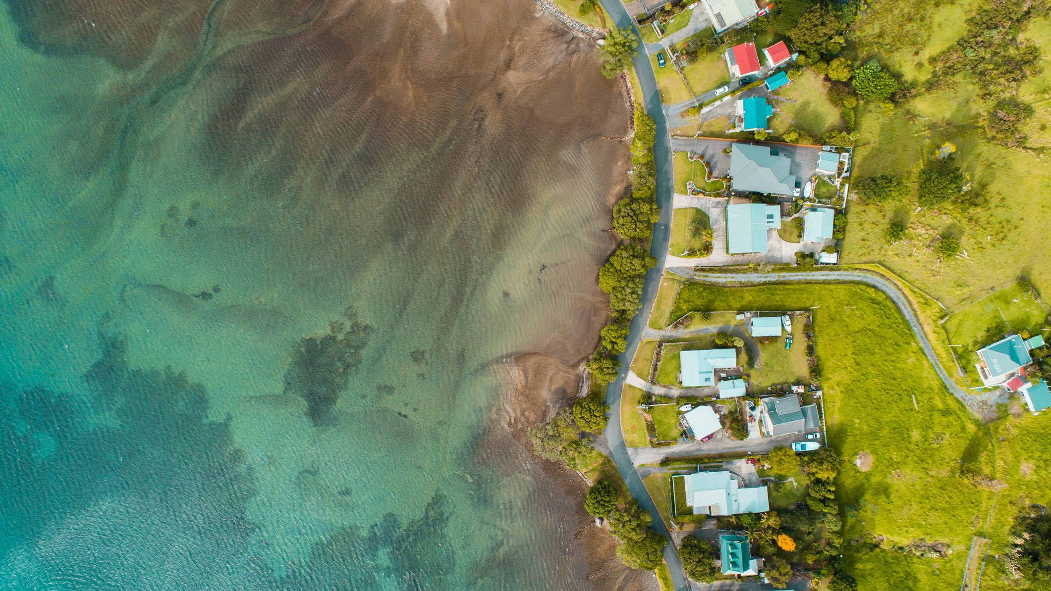 Houses by the beach in an expanding regional property area.