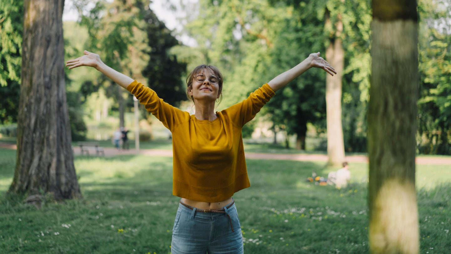 happy-woman-with-arms-outstretched