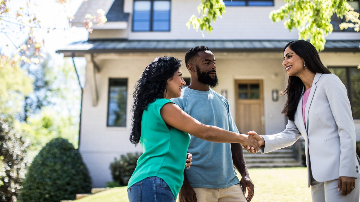 couple buying home as property prices rise