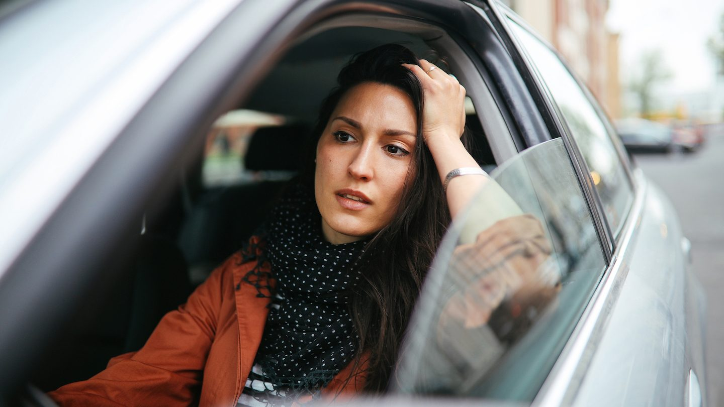 woman stressed about car insurance loyalty traps
