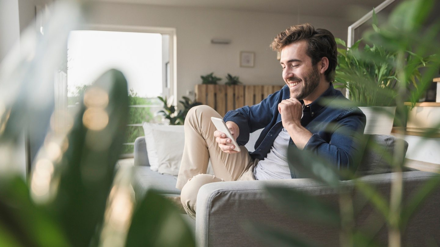 man-looking-at-home-loan-rates-on-phone