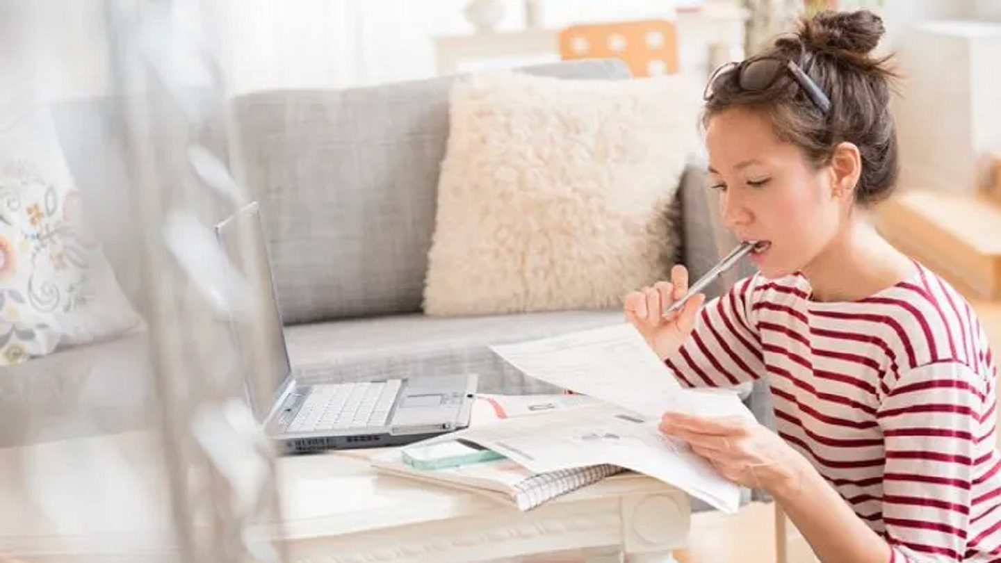 Woman calculating spending on home renovation