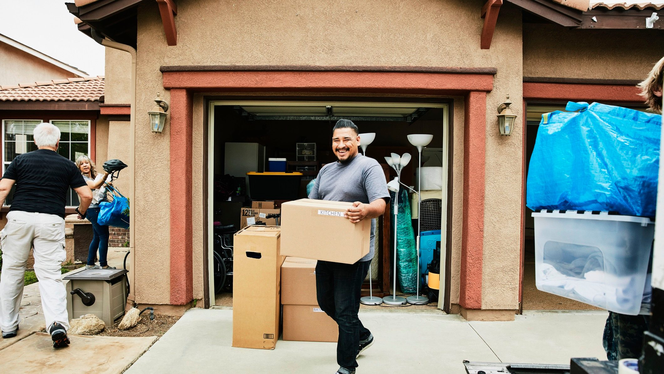 A young man and older family members moving house to get a better priced rental.