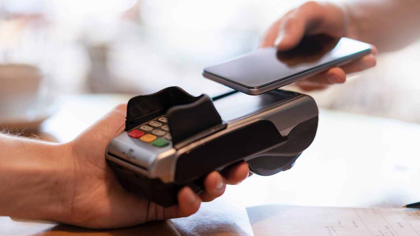 person making digital payment with mobile phone
