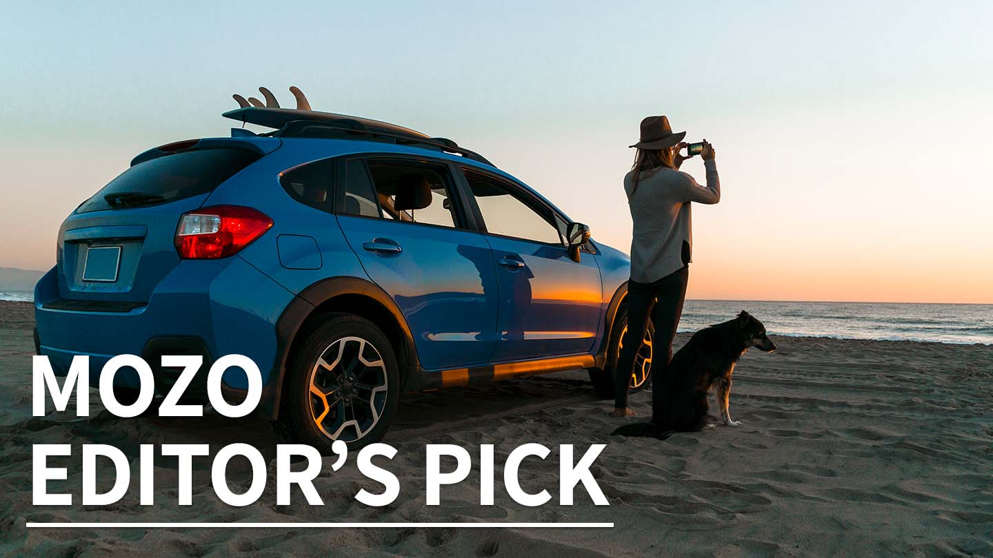 Person with car and dog on a beach at sunset, with the text 'Mozo Editor's Pick' overlaid.