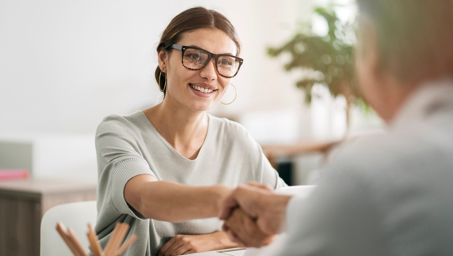 Woman small business owner shaking hands
