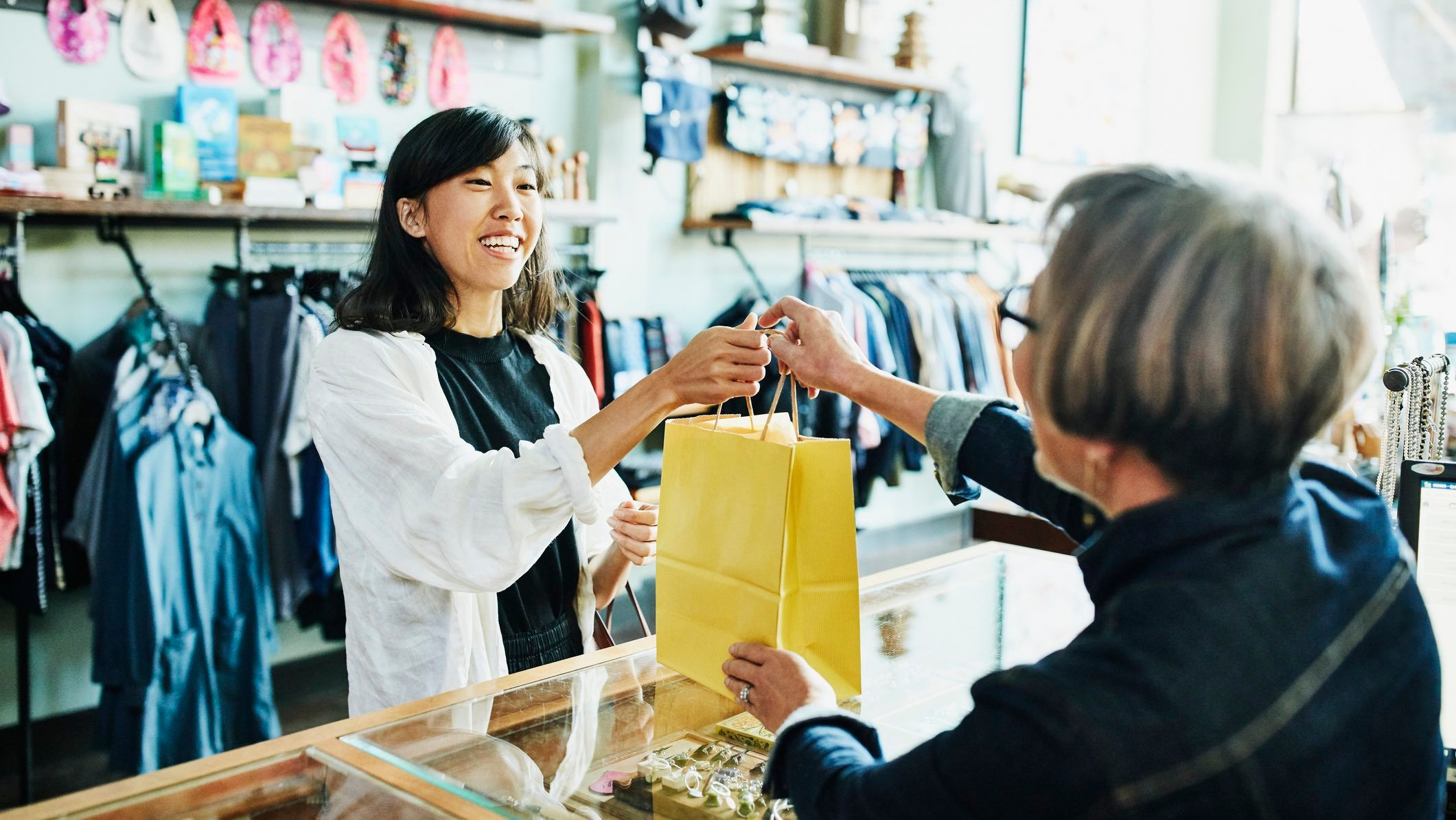 Young person shopping while considering sustainability.