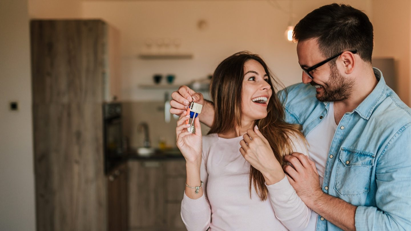 happy-first-home-buyers-with-house-keys